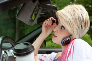 You Did WHAT Behind the Wheel? People Admit to Odd Behavior in New Distracted Driving Survey